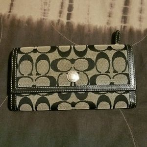 Coach black and tan large wallet